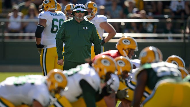 Green Bay Packers coach Mike McCarthy looks on during training camp practice at Ray Nitschke Field on Saturday, Aug. 1, 2015.
