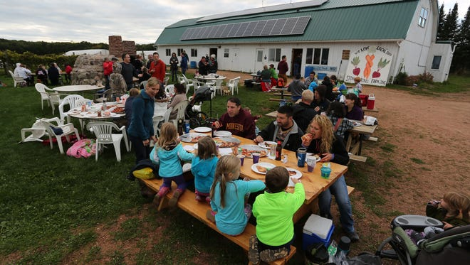 People enjoy pizza at Stoney Acres Farm near Athens, Friday, September 11, 2015.