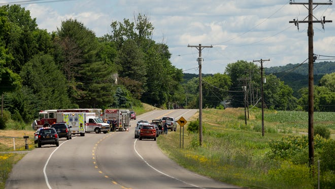 Firefighters, and police officers along with ambulance personal from Groton and Dryden, work at the scene of a serious accident Saturday afternoon near McLean.