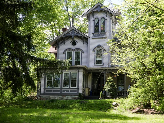 Vintage furniture, a set of concrete lions and a baby grand piano from the 1920s are among the items up for sale a the former Prospect Hill Bed and Breakfast in Romeo.