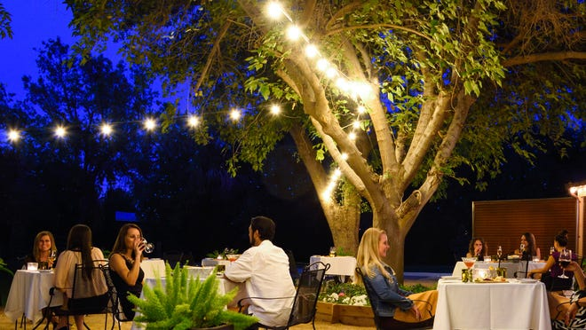 The new Tamarisk Garden Patio at Quiessence, framed by mature mulberry trees, is open just in time for the holiday season.