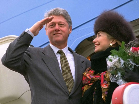 U.S. President Bill Clinton salutes towards the crowd at Moscow's Vnukovo Airport as his wife Hillary looks on Saturday Jan. 15, 1994.  The First Family departed after a successful three day summit with Russian President Boris Yeltsin.  They are now headed for Minsk and Geneva before returning to the United States.