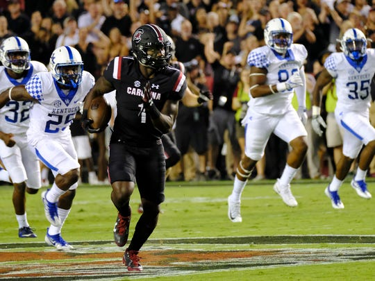 COLUMBIA, SC - SEPTEMBER 16: Wide receiver Deebo Samuel #1 of the South Carolina Gamecocks outruns defenders from the Kentucky Wildcats for a touchdown at Williams-Brice Stadium on September 16, 2017 in Columbia, South Carolina.  (Photo by Todd Bennett/GettyImages)