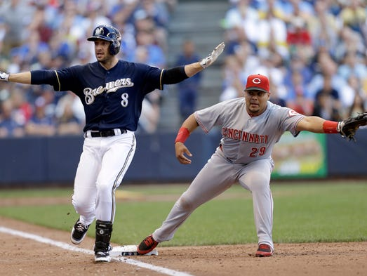 Ryan Braun of the Milwaukee Brewers beats the throw to Brayan Pena at first base for a RBI single in the bottom of the fifth inning.