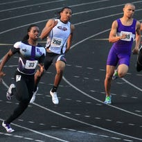 Ben Davis' Derrick Jones, left, sprints down the track to win the 200 meter dash in 21.99 seconds at the high school boys regional track meet at North Central High School in Indianapolis on Thursday, May 29, 2014. Finishing second was Muncie Central's Timmric Woods, second from right, their was James Mitchell of North Central, second from left, and fourth was Sanchez Miller, right, of Southport. The top three advance to the state meet next weekend.