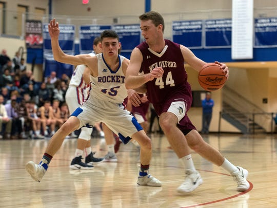 New Oxford's John Wessel (44) drives the ball toward the hoop against Spring Grove's Grant Sterner (15), Tuesday, Dec. 19, 2017. The New Oxford Colonials topped the Spring Grove Rockets, 54-48.
