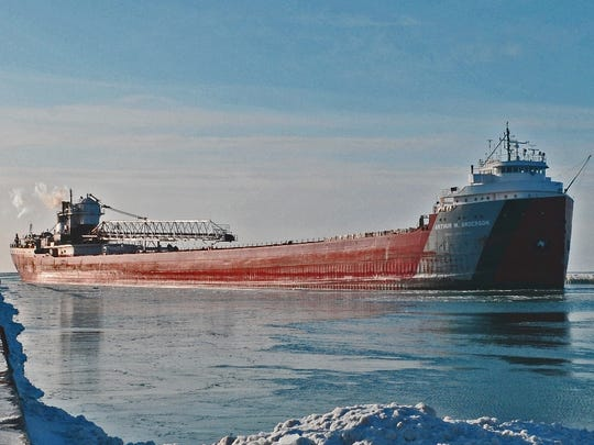 The cargo ship Arthur M. Anderson arrives at the U.S. Coast Guard station on the Sturgeon Bay canal after a grueling journey through the nearly ice-covered Great Lakes.