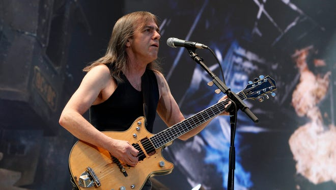 AC/DC guitarist Malcolm Young performs in this 2010 file photo in Berlin, Germany, Olympiastadion