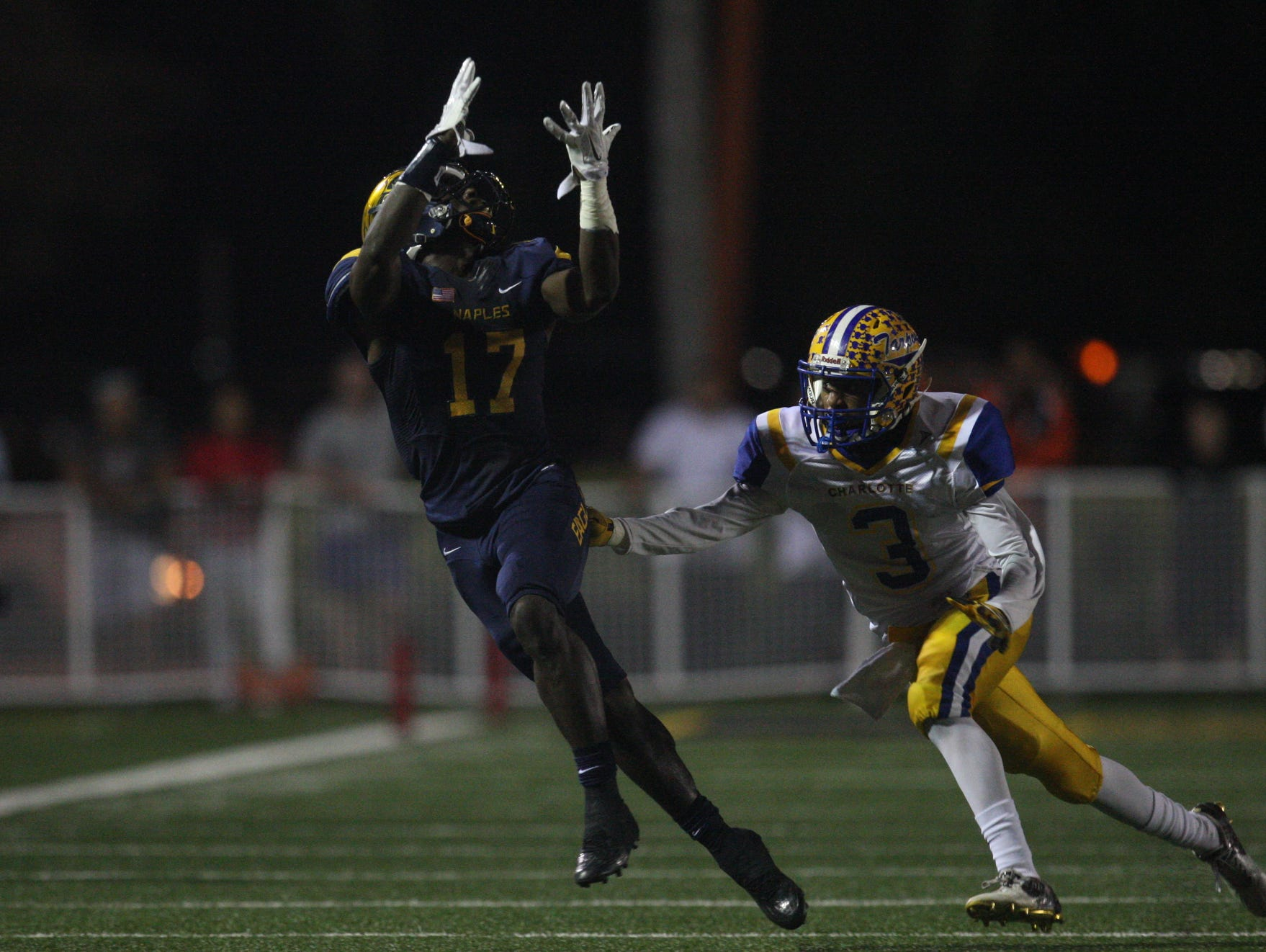 Naples High receiver Tyler Byrd catches a pass during the Golden Eagles 35-0 win over Charlotte in the Region 6A-3 final Friday at Staver Field.