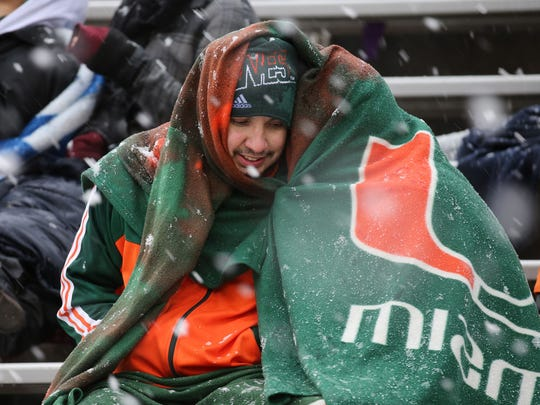 Fans at the 82nd Annual Hyundai Sun Bowl had to weather the storm that made its way into the Sun City on Saturday afternoon during the game. Rain and snow fell throughout the game, when most of the fans made their way to the gates at its strongest point. Washington State beat the University of Miami, 20-14. See more photos at elpasotimes.com and on Pages 4-5C.