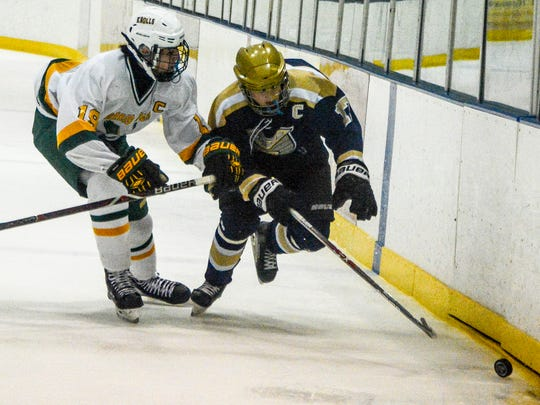 Knolls Ryan Martinez (19) and Roxbury's Billy Hefferle