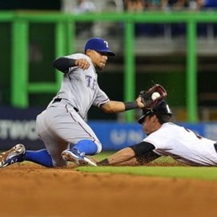 MIAMI, FL - AUGUST 19: Rougned Odor #12 of the Texas Rangers applies the tag as Christian Yelich #21 of the Miami Marlins steals second during a game at Marlins Park on August 19, 2014 in Miami, Florida. (Photo by Mike Ehrmann/Getty Images)