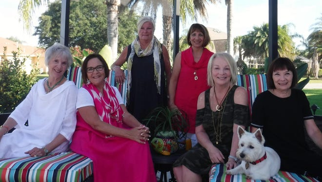 """Girlfriend Vacation - One year after their amazing adventures in France, the self-proclaimed """"Mon Amies"""" gathered for a reunion at the beautiful home of Nan and John Byrd in The Villages, Florida. Enjoying a long weekend together were Karleen Wink, Lucy Himstedt, Pat Bateman, Nan Byrd, Jo Keating and Peggy Chastain. Also pictured is the Byrd's sweet westie, Emmie."""