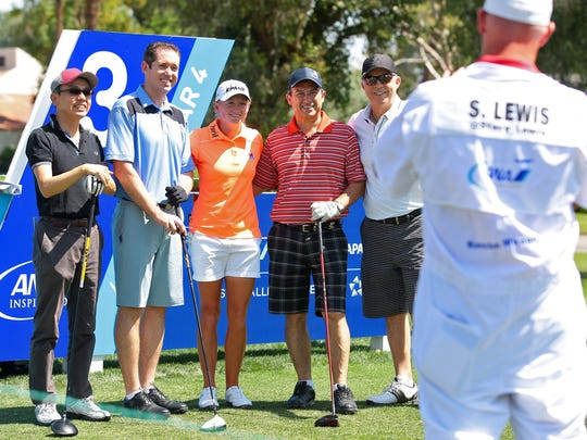 Before hitting tee shots on the third hole Wednesday, April 1, 2015, golfer Stacy Lewis (center) and her pro-am playing partners stop for a group photo being taken by Lewis' caddy. The pro-am was held the day before the ANA Inspiration tees off at Mission Hills Country Club in Rancho Mirage, Calif.