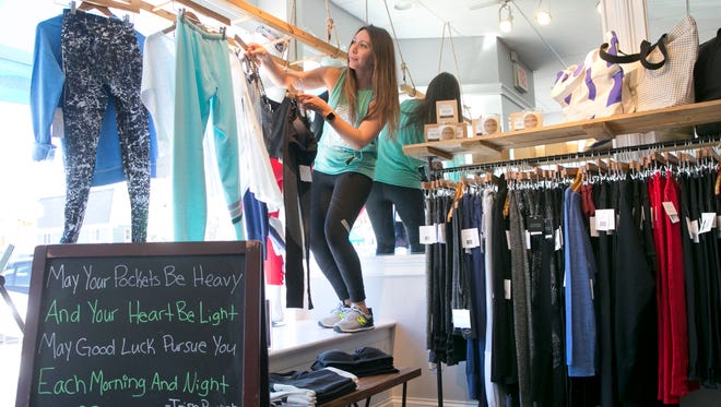 Alison Keating, owner of Barefoot, works in her Spring Lake store.