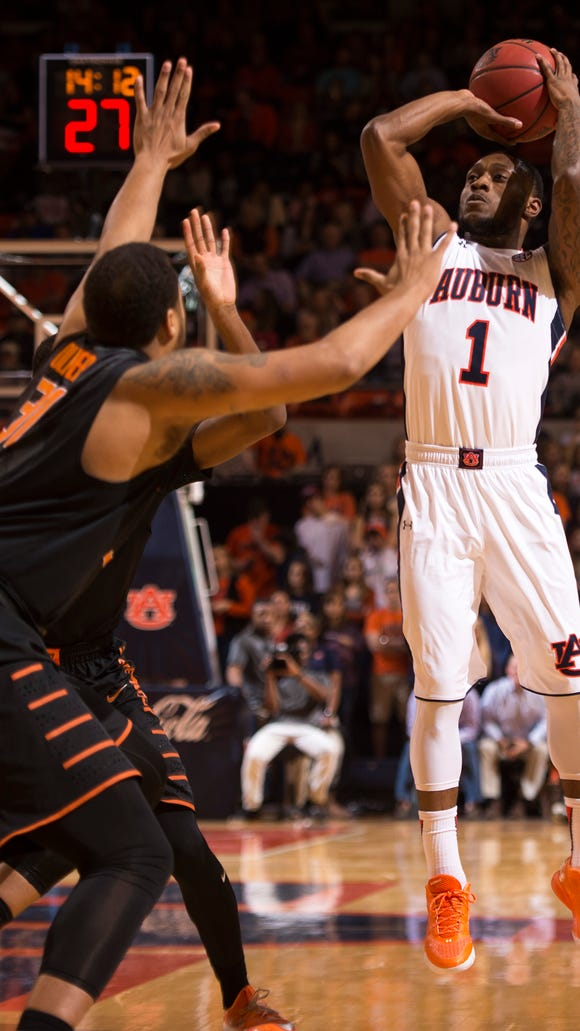 Kareem Canty (1) shooting a jump shot against Oklahoma State in the Big 12/SEC Challenge in Auburn, Ala. on Saturday, Jan. 30, 2016. Canty announced Thursday night his intention to leave the Auburn program to turn professional.