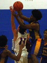 RU's Eric McCarter ascends for a rebound over GC's