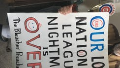 Cubs fan Jerry Pritikin holds a sign he made for the