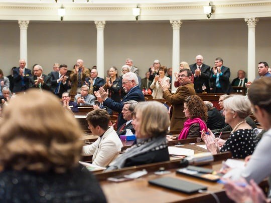 Republican representatives stand and applaud as Gov. Phil Scott delivers his budget address to the Legislature at the Statehouse in Montpelier on Tuesday, January 23, 2018.