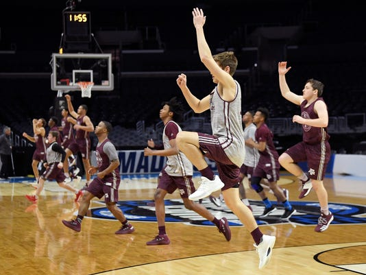 Texas A&M players warm up during practice at the NCAA men's college basketball tournament, Wednesday, March 21, 2018, in Los Angeles. Texas A&M plays Michigan in a regional semifinal on Thursday. (AP Photo/Mark J. Terrill)