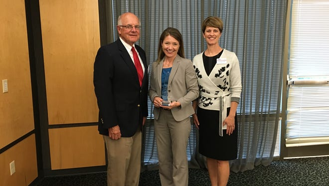 Holly Brenner, 2016 recipient of the Donald G. Jones Leadership Alumni Award, was recognized for her outstanding service to the Fond du Lac community. Pictured from left: Tom Herre, interim president and CEO of the Fond du Lac Area Association of Commerce; Holly Brenner, vice president of strategic development and marketing for Agnesian HealthCare; Lesley Manowske, director of Leadership Fond du Lac.