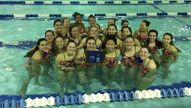 The Mountain Lakes girls team shows off its NJSIAA North 1-C trophy after defeating Demarest on Friday night.