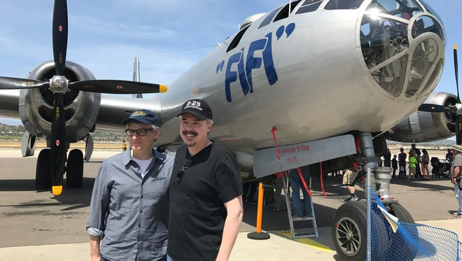 "Peter Gould, left, and Vince Gilligan, co-creators of AMC's ""Better Call Saul,"" pose for fans in front of ""FIFI,"" a warplane staged at the Commemorative Air Force Museum in  Camarillo."