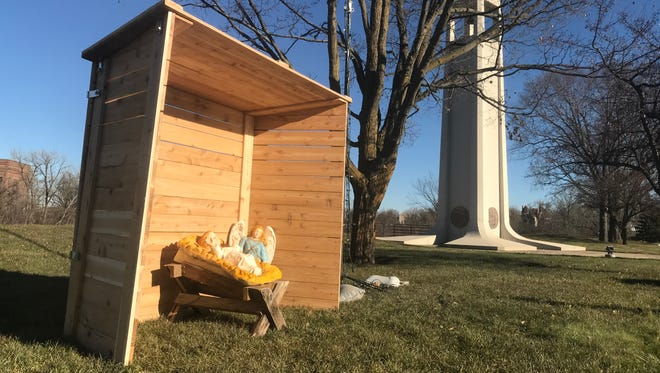 Two volunteers built a new stable for the Nativity display in Wisconsin Rapids' Mead View Park after the former structure was damaged during wind storms last winter.