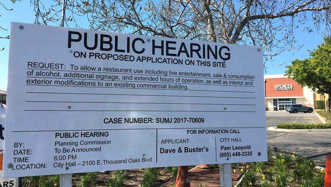 A public hearing notice is seen near the proposed location of Dave & Buster's at the former Sports Authority store in Thousand Oaks. The date of the hearing has yet to be announced.