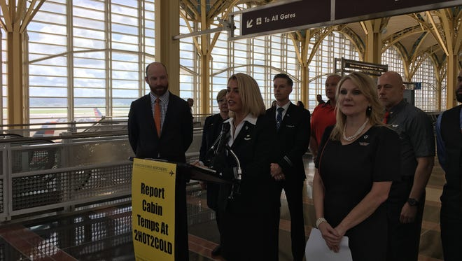 Sara Nelson (center), president of Association of Flight Attendants-CWA, urges the DOT to regulate temperatures aboard airliners during a news conference on Aug. 1, 2018, at Reagan National Airport in Arlington, Va. She is flanked by Greg Regan, secretary-treasurer of the Transportation Trades Department of AFL-CIO, and Lyn Montgomery, president of Transport Workers Union Local 556.