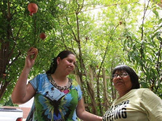 Rosa Ramirez, left, and Yolanda Triana talk under the
