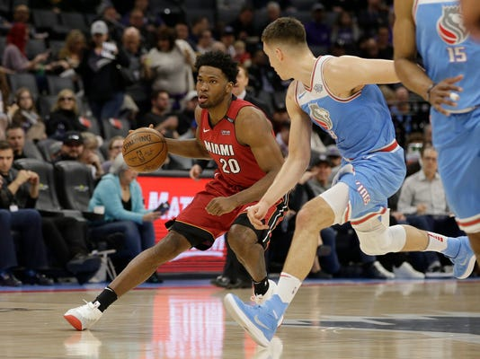 Miami Heat forward Justise Winslow, left, drives against Sacramento Kings guard Bogdan Bogdanovic during the first quarter of an NBA basketball game Wednesday, March 14, 2018, in Sacramento, Calif. (AP Photo/Rich Pedroncelli)