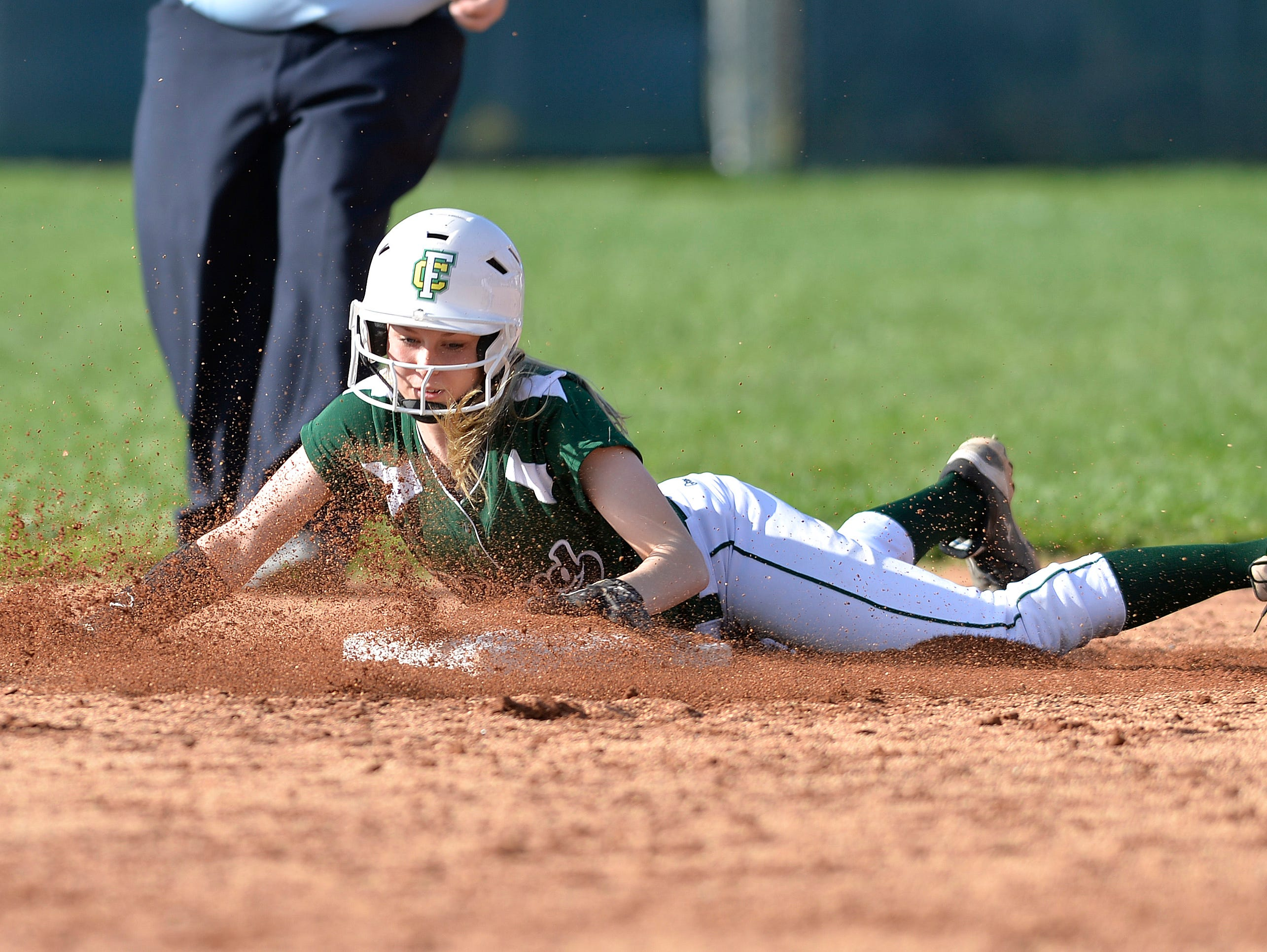 Floyd Central's Jensen Striegel slides in to second base ahead of the tag during their game against Providence Friday, April 10, 2015.