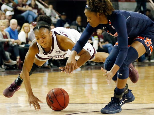 Mississippi State guard Morgan William (2) dives for loose ball in front of Auburn guard Erica Sanders (3) during the first half of an NCAA college basketball game in Starkville, Miss., on Thursday, Feb. 22, 2018.