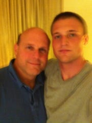 Patrick Allocco of Morris Township and his son, also named Patrick, during their house arrest in Angola in 2012.