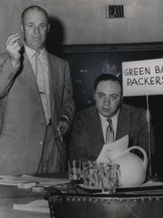 Packers coach Ray (Scooter) McLean (left), with Packers