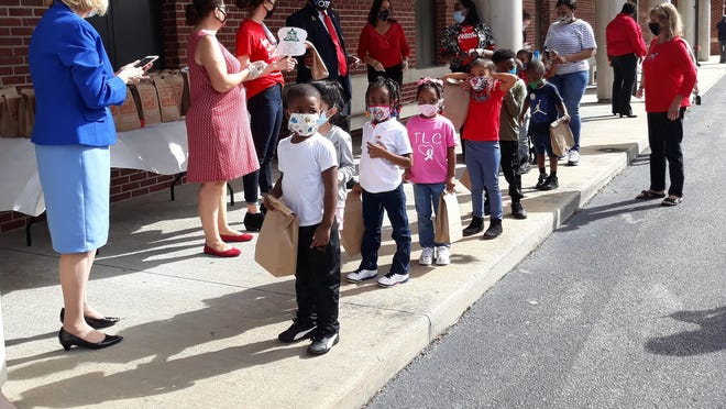 "Savannah-Chatham County Public Schools kicked off ""Red Ribbon Week"" on Friday with a drive-thru event at Formey Early Learning Center. Children received ""goody bags"" for promising to say ""No!"" to drugs."