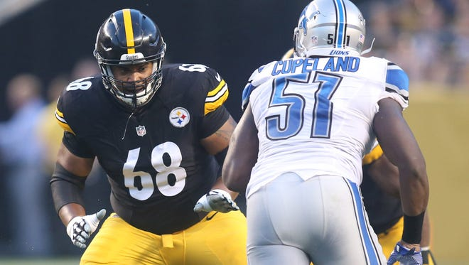Pittsburgh Steelers tackle Ryan Harris (68) blocks at the line of scrimmage against Detroit Lions defensive end Brandon Copeland (51) during the first quarter at Heinz Field.