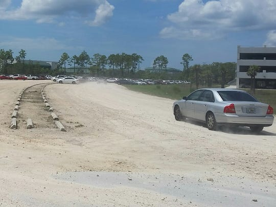 Plenty of parking spaces were available Sept. 3 in a dirt parking lot on the Florida Gulf Coast University campus.
