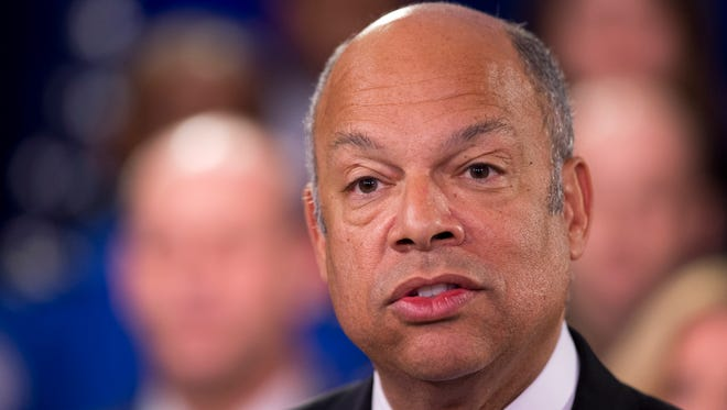 Homeland Security Secretary Jeh Johnson, joined by the department employees, during a news conference in Washington, Monday, Feb. 23, 2015. A partial shutdown of the Homeland Security Department loomed at week's end, but no solution was in sight as senators returned to the Capitol from a week-long recess Monday to confront an impasse over the issue.