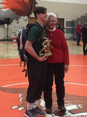 Jeanne Flanegan presents Madison's Carson Speelman with the Bill Flanegan Most Outstanding Wrestler Award at the conclusion of the 55th J.C. Gorman Invitational.