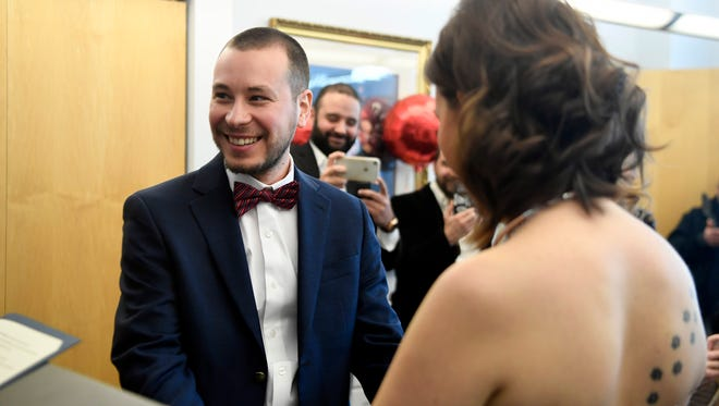 Erhan Alansu smiles after reciting his vows to his wife Zeynep Yilmaz during their wedding at the Bergen County Courthouse in Hackensack, NJ on Valentines Day, Tuesday, February 14, 2017.