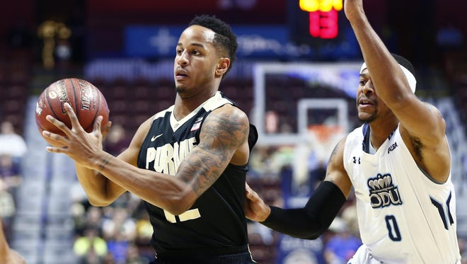 Purdue Boilermakers forward Vince Edwards (12) passes the ball against Old Dominion Monarchs guard Jordan Baker (0) during the first half at Mohegan Sun Arena.