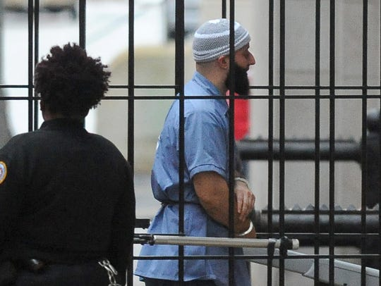 Adnan Syed enters Courthouse East in Baltimore prior