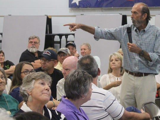 Powdersville resident Steve Cooper voices his opposition to zoning regulations during a meeting at Powdersville Middle School.