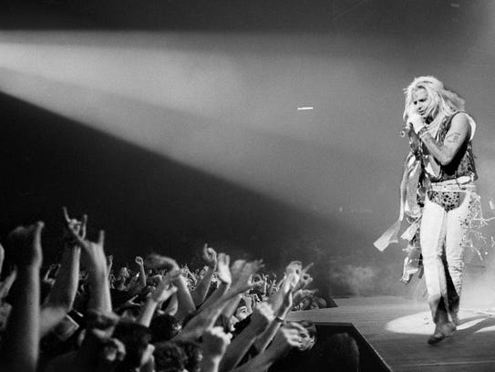 Vince Neil performing with Motley Crue in 1985, when