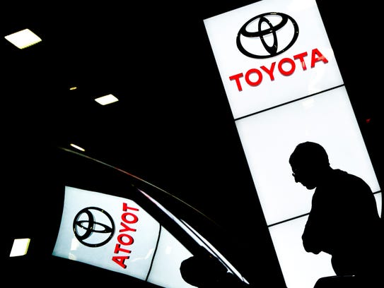 A man checks out featured Toyota vehicles at the annual