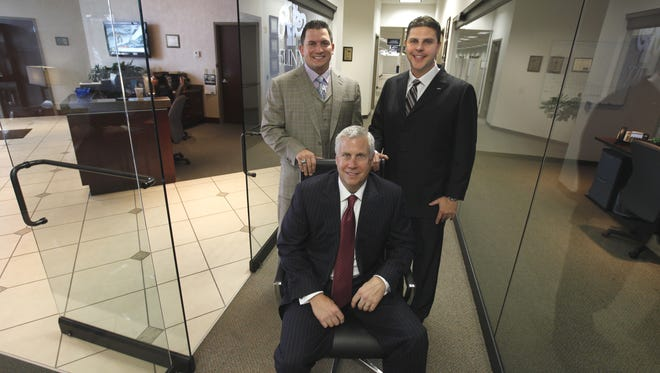 From left: Jason Guck, Craig Jerabeck and Jeb Tyler are shown in the 5LINX office in Henrietta in this 2012 photo.