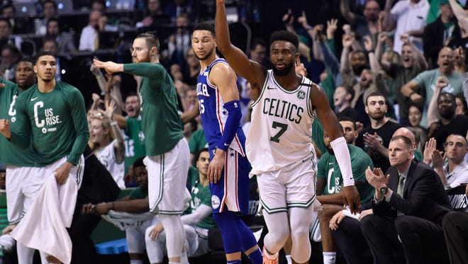 Boston Celtics guard Jaylen Brown (7) reacts after making a three point basket during the first half in game two of the second round of the 2018 NBA Playoffs against the Philadelphia 76ers at TD Garden.