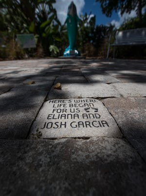"""Personalized pavers with distinct messages serve as ground cover next to the """"Healing Garden"""" area of the Pathway to Discovery at Cape Coral Hospital. The garden serves as a place for reflection as part of the hospital's effort to provide an optimal healing environment."""